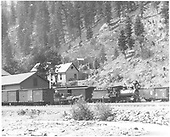 3/4 engineer's-side view of D&amp;RG #259 at the Ouray depot with a passenger train.  A wagon is standing near the baggage car for express shipments, while the drayman talks with the engineer.<br /> D&amp;RG  Ouray, CO  ca. 1889