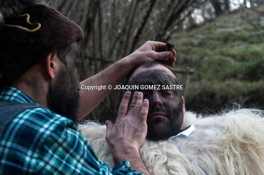 The zarramacos dress and make up in the forest before starting to celebrate the vijanera (first winter carnival) that takes place in Cantabria (Spain).