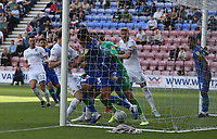 Leeds United's Patrick Bamford (partly hidden by post) scores his side's second goal <br /> <br /> Photographer Stephen White/CameraSport<br /> <br /> The EFL Sky Bet Championship - Wigan Athletic v Leeds United - Saturday 17th August 2019 - DW Stadium - Wigan<br /> <br /> World Copyright © 2019 CameraSport. All rights reserved. 43 Linden Ave. Countesthorpe. Leicester. England. LE8 5PG - Tel: +44 (0) 116 277 4147 - admin@camerasport.com - www.camerasport.com