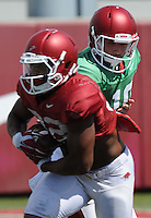NWA Democrat-Gazette/ANDY SHUPE<br /> Arkansas quarterback Brandon Allen (10) hands the ball off Tuesday, Aug. 11, 2015, to running back Jonathan Williams during practice at the university's practice field in Fayetteville.