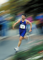 Male runner during 1 2 marathon road race, racing, races, competition, endurance, speed, motion, blurred backround, man, men; NR.