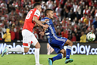 BOGOTA - COLOMBIA, 07-09-2019: Daniel Giraldo del Santa Fe disputa el balón con Jhon Duque Arias de Millonarios durante partido entre Independiente Santa Fe y Millonarios por la fecha 10 de la Liga Águila II 2019 jugado en el estadio Nemesio Camacho El Campín de la ciudad de Bogotá. / Daniel Giraldo of Santa Fe vies for the ball with Jhon Duque Arias of Millonarios during match between Independiente Santa Fe and Millonarios for the date 10 as part of the Aguila League II 2019 played at Nemesio Camacho El Campín stadium in Bogota city. Photo: VizzorImage / Gabriel Aponte / Staff