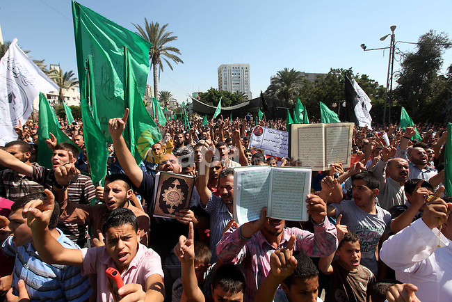 Palestinians shout anti-U.S. slogans during a demonstration against the controversial film 'Innocence of Muslims' in Gaza City, on September 14, 2012. The controversial low budget film reportedly made by an Israeli-American which portrays Muslims as immoral and gratuitous, sparked fury in Libya, where four Americans including the ambassador were killed on Tuesday when a mob attacked the US consulate in Benghazi, and has led to protests outside US missions in Morocco, Sudan, Egypt, Tunisia and Yemen. Photo by Majdi Fathi