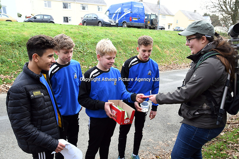 COPY BY TOM BEDFORD<br /> Pictured: Bird watchers are given hot drinks by locals as they gather to watch the masked wagtail in the village of Camrose, west Wales, UK. Saturday 03 December 2016<br /> Re: Birdwatchers from all over Britain have turned up in a tiny Welsh village to see the first recorded visit of a masked wagtail.<br /> The species is normally found in Kazakhstan, Iran and Afghanistan but may have been brought here by the icy temperatures.<br /> It was spotted on the roof of a semi-detached house in Camrose, Pembrokeshire, yesterday(tues) but local birdwatchers were unable to identify it.<br /> An expert arrived and the bird was confirmed as the masked wagtail which has never been seen before in the British Isles.<br /> More than 40 twitchers drove through the night and slept in their cars to get the first glimpse of the bird seen flying between chimney pots in the village.<br /> Police were called because so many visitors turned up in the village, blocking country lanes and disturbing locals.<br /> But most locals welcomed the  birdwatchers, even making them cups of tea as they kept watch on the bird with binoculars and cameras.