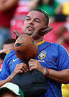 A Brazilian fan holds an inflatable kangeroo