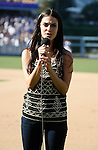 "LOS ANGELES, CA. - September 19: Jessica Lowndes sings ""God Bless America"" during the game between the Los Angeles Dodgers and the San Fransisco Giants at the Dodger Stadium on September 19, 2009 in Los Angeles, California."