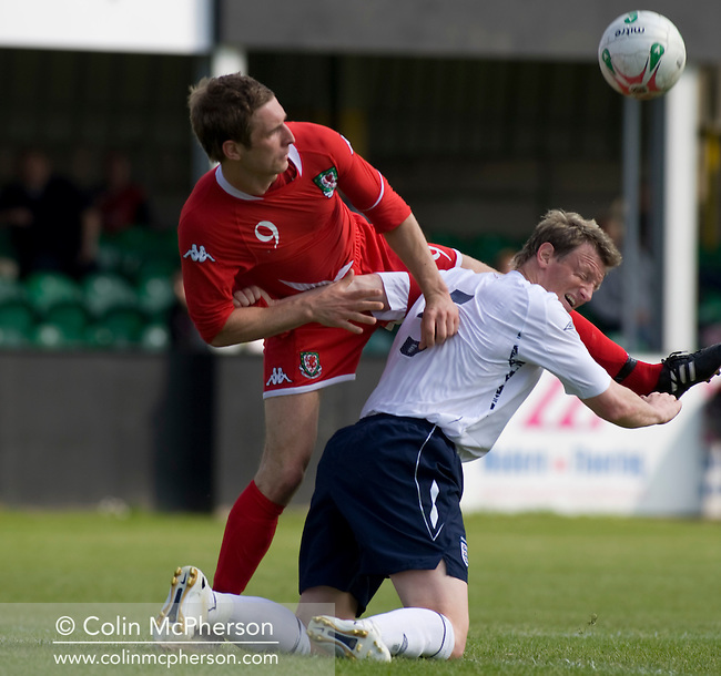 England's captain Wayne Hatswell in action against Wales' Rhys Griffiths during the Four Nations Semi-Professional tournament match at Rhyl which the English won 3-0 and with it the tournament. The tournament was established in 2002 and was held on an annual basis featuring teams from England, Scotland and Wales and an invited team, on this occasion Gibraltar. The tournament is hosted on a rotational basis and in 2008 games were staged at Colwyn Bay FC, Rhyl FC and The New Saints ground in Oswestry.