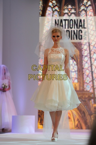 Bride .The National Wedding Show, Olympia, London, England..23rd February 2013 .runway full length model lace veil white dress .CAP/IA.©Ian Allis/Capital Pictures.