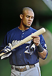 21 September 2012: Milwaukee Brewers outfielder Carlos Gomez checks out a new bat prior to a game against the Washington Nationals at Nationals Park in Washington, DC. The Brewers rallied in the 9th inning to defeat the Nationals 4-2 in the first game of their 4-game series. Mandatory Credit: Ed Wolfstein Photo