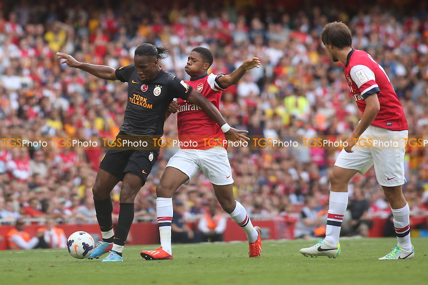 Galatasaray's Didier Drogba shields the ball from Chuba Akpom of Arsenal - Arsenal vs Galatasaray - Emirates Cup Football at The Emirates Stadium, London - 04/08/13 - MANDATORY CREDIT: Paul Dennis/TGSPHOTO - Self billing applies where appropriate - 0845 094 6026 - contact@tgsphoto.co.uk - NO UNPAID USE
