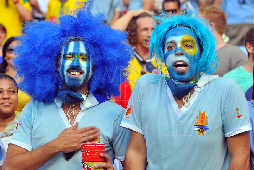 BELO HORIZONTE - BRASIL -28-06-2014. Los hinchas uruguayos disfrutan del juego de los octavos de final en el estadio Maracaná de Rio de Janeiro entre Colombia (COL) y Uruguay (URU), hoy 29 de junio de 2014, por la Copa Mundial de la FIFA Brasil 2014./ Fans of Uruguay enjoy the match of the Round of 16 at Maracana stadium in Rio do Janeiro between Colombia (COL) and Grece(GRC), today June 28 2014 for the 2014 FIFA World Cup Brazil. Photo: VizzorImage / Alfredo Gutiérrez / Contribuidor