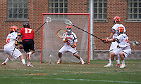 Adam Ghitelman (8) of Virginia looks to save the shot of Bryn Holmes (17) of Maryland during the ACC men's lacrosse tournament finals in College Park, MD.  Virginia defeated Maryland, 10-6.