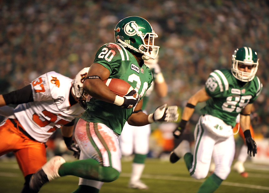 The Saskatchewan Roughriders' Wes Cates shakes off a tackle against the B.C. Lions during the CFL's Western Division semifinal game in Regina Sunday, November 14, 2010. THE CANADIAN PRESS/Mark Taylor.