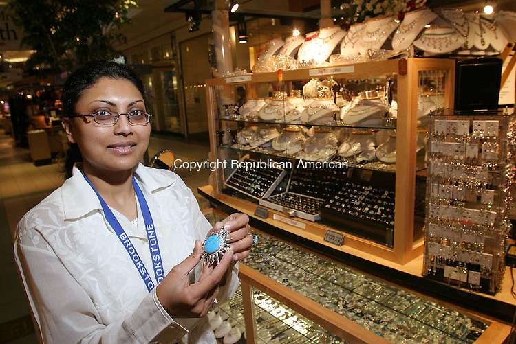 WATERBURY, CT - 24 May 2005 -052405BZ04- Shital Mepani, owner of a retail jewelry business called &quot;Rare Jewelry&quot; displays a turquoise necklace in front of her 5x10-foot cart in the center aisle of the Brass Mill Center's lower floor Tuesday afternoon.  <br /> <br /> Jamison C. Bazinet Photo