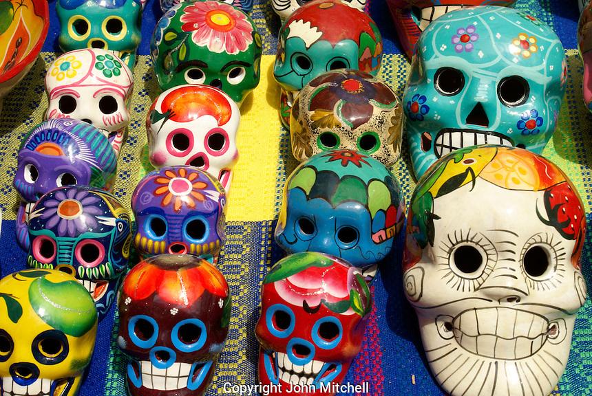 Colourful Mexican ceramic skulls or calveras  in Playa del Carmen, Riviera Maya, Quintana Roo, Mexico.