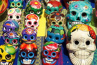 Colourful Mexican ceramic skulls or calveras  in Playa del Carmen, Riviera Maya, Quintana Roo, Mexico.