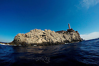 A lighthouse is seen during a boat tour on Monday, Sept. 21, 2015, off the island of Capri in Italy. (Photo by James Brosher)