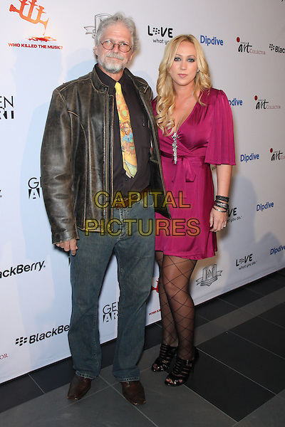 RON LIPKING & ASHLEY LIPKING.Will.i.am welcomes celebrities & artists to opening night of the art collection, Who Killed The Music?, benefitting the i.am Scholarship Foundation held at Target Terrace Lounge, Los Angeles, California, USA..January 24th, 2010.full length jeans denim brown leather jacket pink dress.CAP/ADM/RAT.©Ratianda/Admedia/Capital Pictures