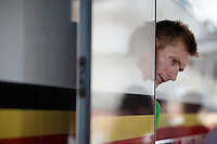 Andr&eacute; Greipel (DEU/Lotto-Soudal) peeping out of the bus for the first time in his green jersey<br /> <br /> stage 3: Antwerpen (BEL) - Huy (BEL)<br /> 2015 Tour de France