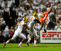 Kendal Thompkins of the Hurricane is hit after failing to haul in the ball. Maryland defeated Miami 32-24 during a game at the Byrd Stadium in College Park, MD on Monday, September 5, 2011. Alan P. Santos/DC Sports Box