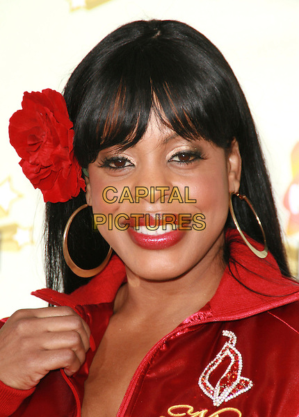 NIECY NASH.20th Annual Nickelodeon Kids' Choice Awards held at UCLA's Pauley Pavilion, Westwood, California, USA..March 31st, 2007.headshot portrait red flower in hair lipstick gold hoop earrings .CAP/ADM/CH.©Charles Harris/AdMedia/Capital Pictures