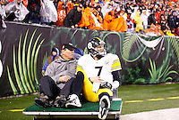 Ben Roethlisberger #7 of the Pittsburgh Steelers is carted off of the field with a shoulder injury after being sacked by Vontaze Burfict #55 of the Cincinnati Bengals in the second half during the Wild Card playoff game at Paul Brown Stadium on January 9, 2016 in Cincinnati, Ohio. (Photo by Jared Wickerham/DKPittsburghSports)