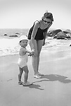 Mother and daughter at the beach. 1940's black and white.