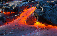 "Molten ""Dragon"" Rock: A close-up of molten lava cooling and creating shapes of Earth that last only seconds, 61g Flow, Hawai'i Volcanoes National Park, Big Island. A tumulus (domelike swelling of congealed lava) breaks out less than 20 feet from where this photo was taken. By far, one of the largest, hottest, and fastest observed breakouts on the 61g surface flow field. The type of cooled lava shown here is blue pahoehoe (lava with a smooth or ropy surface)."