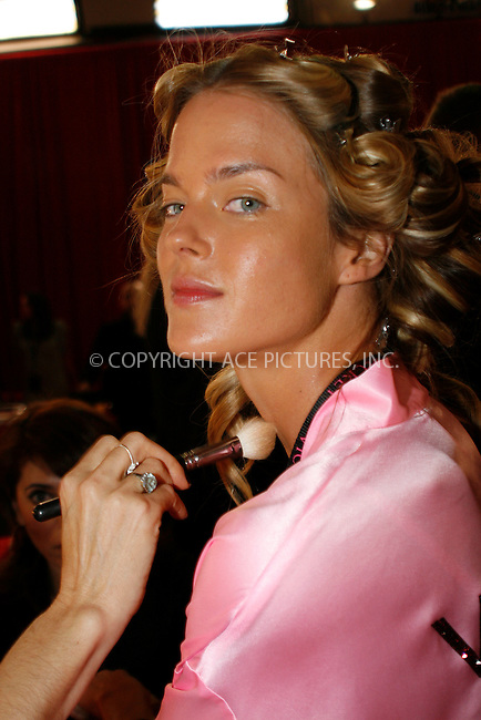 WWW.ACEPIXS.COM . . . . .  ....November 10 2010, New york City....A model has hair and make up done prior to the 2010  Victoria's Secret runway show at the Lexington Armoury on November 10 2010 in New York City....Please byline: NANCY RIVERA- ACEPIXS.COM.... *** ***..Ace Pictures, Inc:  ..Tel: 646 769 0430..e-mail: info@acepixs.com..web: http://www.acepixs.com