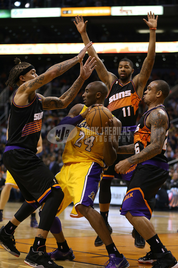 Jan. 30, 2013; Phoenix, AZ, USA: Los Angeles Lakers guard Kobe Bryant (24) controls the ball against the Phoenix Suns in the second quarter at the US Airways Center. Mandatory Credit: Mark J. Rebilas-