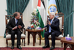 Palestinian President Mahmoud Abbas meets with the Minister of Foreign Affairs of Italy in the West Bank city of Ramallah on January 29, 2019. Photo by Thaer Ganaim