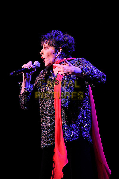 Liza Minnelli.performing in concert, Royal Festival Hall, London, England, UK, .1st March 2013..live music on stage in concert half length red scarf black jacket holding side signing microphone .CAP/MAR.© Martin Harris/Capital Pictures.