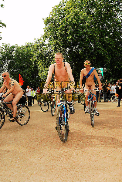 CYCLISTS.Taking part in The World Naked Bike Ride, which protests on the subject of the world's oil dependency and aims to curb  car culture, London, england, June 9th 2006..full length nude bikes cycling riding bicycle protesters race.CAP/IA.©Ian Allis/Capital Pictures