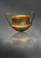 Two handled Mycenaean gold bowl cup from the Kakovatos tholos tomb, Trifylia, Greece. National Archaeological Museum Athens.  Grey art Background <br /> <br /> Kakovatos is a significant site of the early Mycenaean period of Greece (c. 16th to 15th century BC) on the west coast of the Peloponnese (Zacharo, Nomos Elis) and became widely known through the excavations of three large tholos tombs by Wilhelm Dörpfeld in 1907–1908.