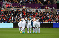 Swansea players huddle before the Premier League match between Swansea City and Hull City at the Liberty Stadium, Swansea on Saturday August 20th 2016
