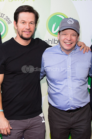 LAS VEGAS, NV - March 28, 2017: ***HOUSE COVERAGE***  Mark Wahlberg and Paul Wahlberg pictured as Mark and Paul Wahlberg attend event at Wahlburgers at The Grand Bazaar Shops at Bally's in Las vegas, NV on March 28, 2017. Credit: Erik Kabik Photography/ MediaPunch