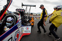 Feb 23, 2014; Chandler, AZ, USA; Members of the NHRA safety safari spray out a header fire on the car of top fuel dragster driver Antron Brown after winning the Carquest Auto Parts Nationals at Wild Horse Motorsports Park. Mandatory Credit: Mark J. Rebilas-USA TODAY Sports