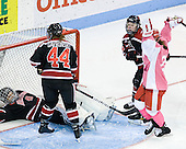 Jill Cardella (BU - 22) celebrates her goal scored on Florence Schelling (Northeastern - 41) to tie the game at 1. - The Boston University Terriers defeated the visiting Northeastern University Huskies 3-2 on Saturday, January 28, 2012, at Agganis Arena in Boston, Massachusetts.