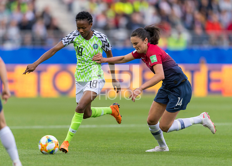 REIMS, FRANCE - JUNE 8: Halimatu Ayinde #18 of Nigeria dribbles past Ingrid Syrstad Engen #14 of Norway during a 2019 FIFA Women's World Cup match between Norway and Nigeria at Stade Auguste-Delaune on June 8, 2019 in Reims, France.