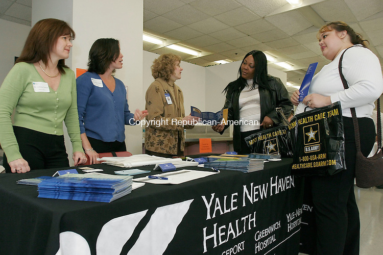 WATERBURY, CT-13 April 2005-041305TK04(left to right:)  The Cooperative Education Department of the Naugatuck Valley Community College held a Career Fair Wednesday at the school as representatives from 64 area employers welcomed college and visiting high school students. Representative Lorraine Iversen, Jennifer Badeau and Julie Lamb of the Bridgeport and Yale-New Haven Hospitals share information with NVCC students Dawn Reynolds and Jennifer Gatling. Tom Kabelka staff photo (Lorraine Iversen, Jennifer Badeau, Julie Lamb, Dawn Reynolds, Jennifer Gatling, Naugatuck Valley Community College, Bridgeport and Yale-New Haven Hospitals)CQ
