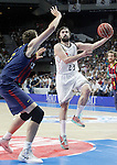 Real Madrid's Sergio Llull (r) and FC Barcelona's Tibor Pleiss during Liga Endesa ACB 2nd Final Match.June 21,2015. (ALTERPHOTOS/Acero)