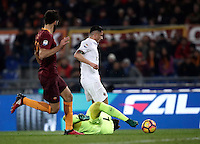 Calcio, Serie A: Roma vs Milan. Roma, stadio Olimpico, 12 dicembre 2016.<br /> Milan's Gianluca Lapadula, right, chased by Roma's Federico Fazio, left, is fouled by goalkeeper Wojciech Szczesny during the Italian Serie A football match between Roma and AC Milan at Rome's Olympic stadium, 12 December 2016.<br /> UPDATE IMAGES PRESS/Isabella Bonotto