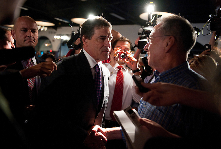 UNITED STATES - AUGUST 14:  Republican presidential candidate Texas Gov. Rick Perry, right, talks with Sen. Chuck Grassley, R-Iowa, at the Lincoln Day Dinner hosted by the Black Hawk County Republican Party in Waterloo, Iowa.  Candidates Perry, Rep. Michele Bachmann, R-Minn., and Rick Santorum, addressed the gathering.  (Photo By Tom Williams/Roll Call)