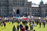 Protesters gather on the front lawn of the  Parliament Buildings in downtown Victoria, BC for the Get Out Migration Rally, May 8th, 2010.  The rally is the final stop for Alexandra Morton, who walked from Sointula to Victoria to protest open-net salmon  farming.  Photo by Gus Curtis