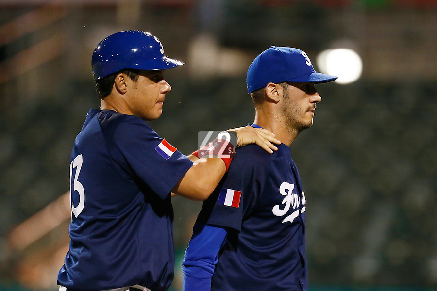 21 September 2012: Matthieu Brelle-Andrade is congratulated by Boris Marche as he walks back to the dugout during France vs South Africa tie game 2-2, rain delayed at the end of the 9th inning at 1 AM, during the 2012 World Baseball Classic Qualifier round, in Jupiter, Florida, USA. Game to resume 22 September 2012 at noon.