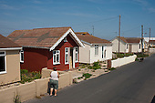 Vandalised bungalows on the Brooklands Estate in Jaywick Sands, close to the Essex resort of Clacton-on-Sea.  The estate's small wooden houses - many little bigger than beach huts - were originally built as holiday homes. Brooklands is the most deprived ward in the UK, according to the latest Indices of Multiple Deprivation.