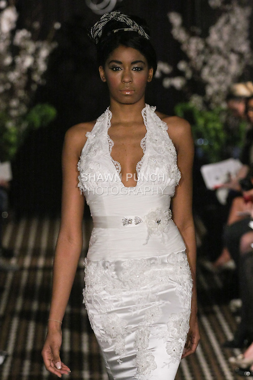 Model walks runway in a Seduction wedding dress by Sarah Jassir, for the Sarah Jassir Fall 2011 - Desire bridal collection.