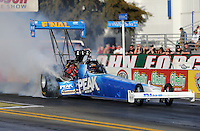 Feb. 14, 2013; Pomona, CA, USA; NHRA top fuel dragster driver T.J. Zizzo during qualifying for the Winternationals at Auto Club Raceway at Pomona.. Mandatory Credit: Mark J. Rebilas-