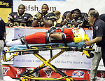 SIOUX FALLS, SD - JUNE 23:  Rachman Crable #52 from the Sioux Falls Storm is brought off the field on a stretcher to the applause of players from the Lee Valley Steelhawks in the first quarter of their first round playoff game Saturday night at the Sioux Falls Arena. (Photo by Dave Eggen/Inertia)