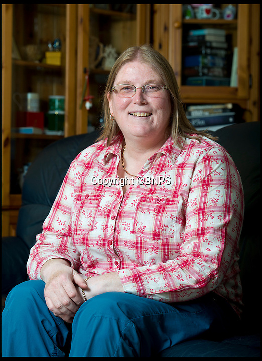 BNPS.co.uk (01202 558833)<br /> Pic: RachelAdams/BNPS<br /> <br /> ***Please use full byline***<br /> <br /> Wendy Morrell at home in Bournemouth. <br /> <br /> A woman was startled when a huge eagle swooped into her front room and landed on a cabinet while she was watching TV.<br /> <br /> Wendy Morrell couldn't believe her eyes when the 18ins tall bird of prey flew through open patio doors and into her lounge in Poole, Dorset, yesterday.<br /> <br /> The bird, a Russian Steppe eagle, knocked over ornaments with its 4ft wings as it landed on a wooden glass cabinet before pecking at a bowl of pot pourri.<br /> <br /> Wendy and friend Karen Ruddlesden tried to tempt the eagle outside using pieces of ham but when their attempts failed they phoned a local bird of prey rescue centre.<br /> <br /> After 30 minutes of trying the eagle was eventually lured down off its makeshift perch using a dead chick.<br /> <br /> It was revealed later that the young bird was called Storm and was being trained up to ward off seagulls at a nearby landfill site.<br /> <br /> It had been reported missing by owner James Moore three days prior to turning up at Wendy's house after it broke its tethers.